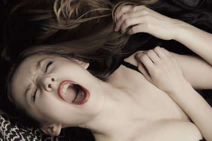 young woman shouting in ecstasy